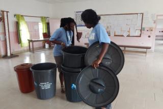 ladies keeping garbage containers